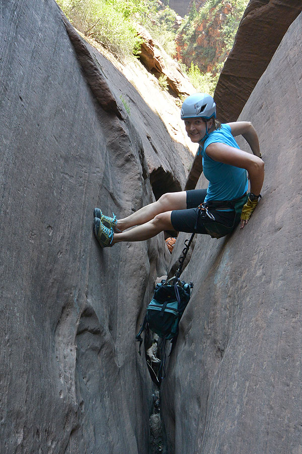 Kim downclimbing
