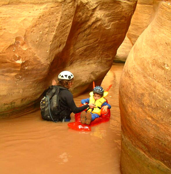 Some beginning canyoneers require special equipment and attention. Photo by Diane Burrows