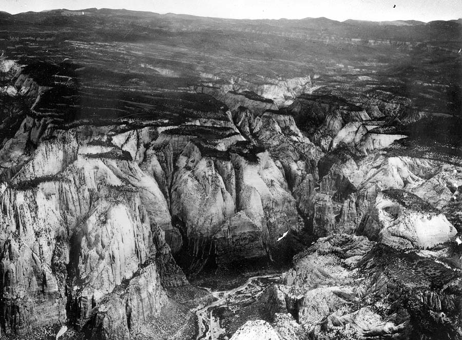 Erosion surface developed on Carmel formation. Flatlands (upper middle) are in process of dissection by Virgin River (bottom center) and its tributaries. The view includes 14 canyons, each as much as 800 feet deep. Washington County, Utah.n.d. (Photo by National Park Service)