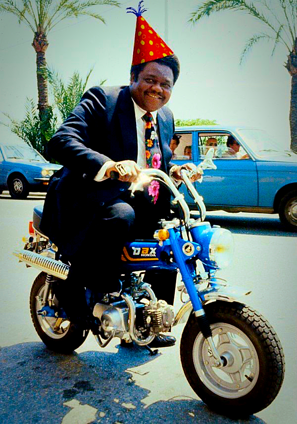 Fats Domino free wheelin' and wearing a party hat that we may or may not have added.