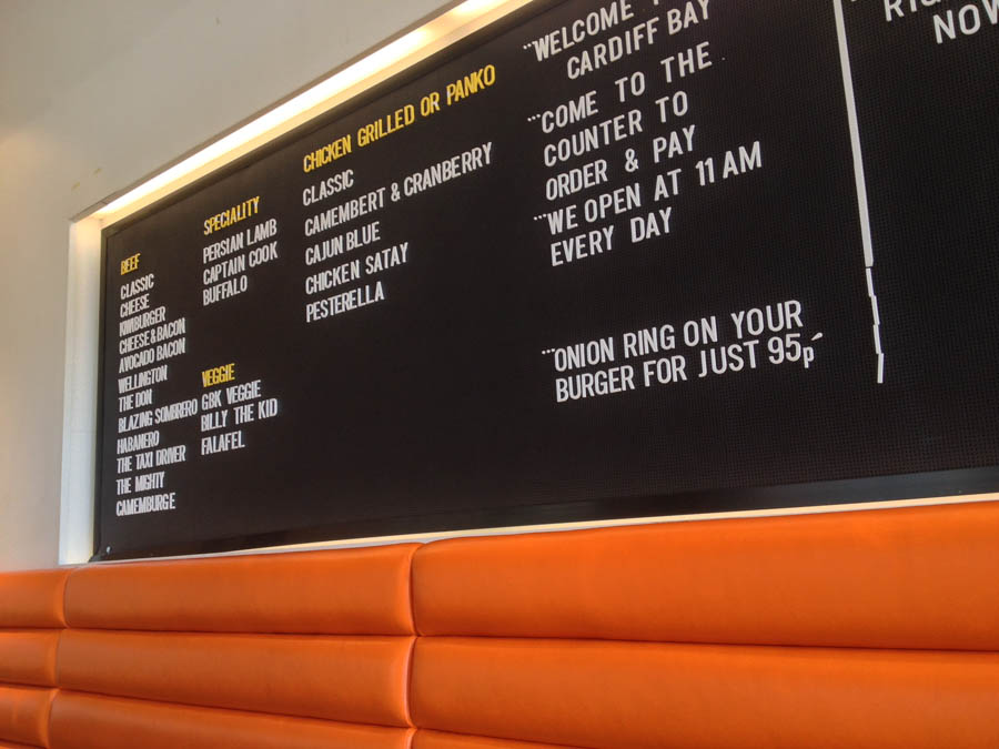 The menu board in Gourment Burger Kitchen is a nice touch of kistch and functionality.