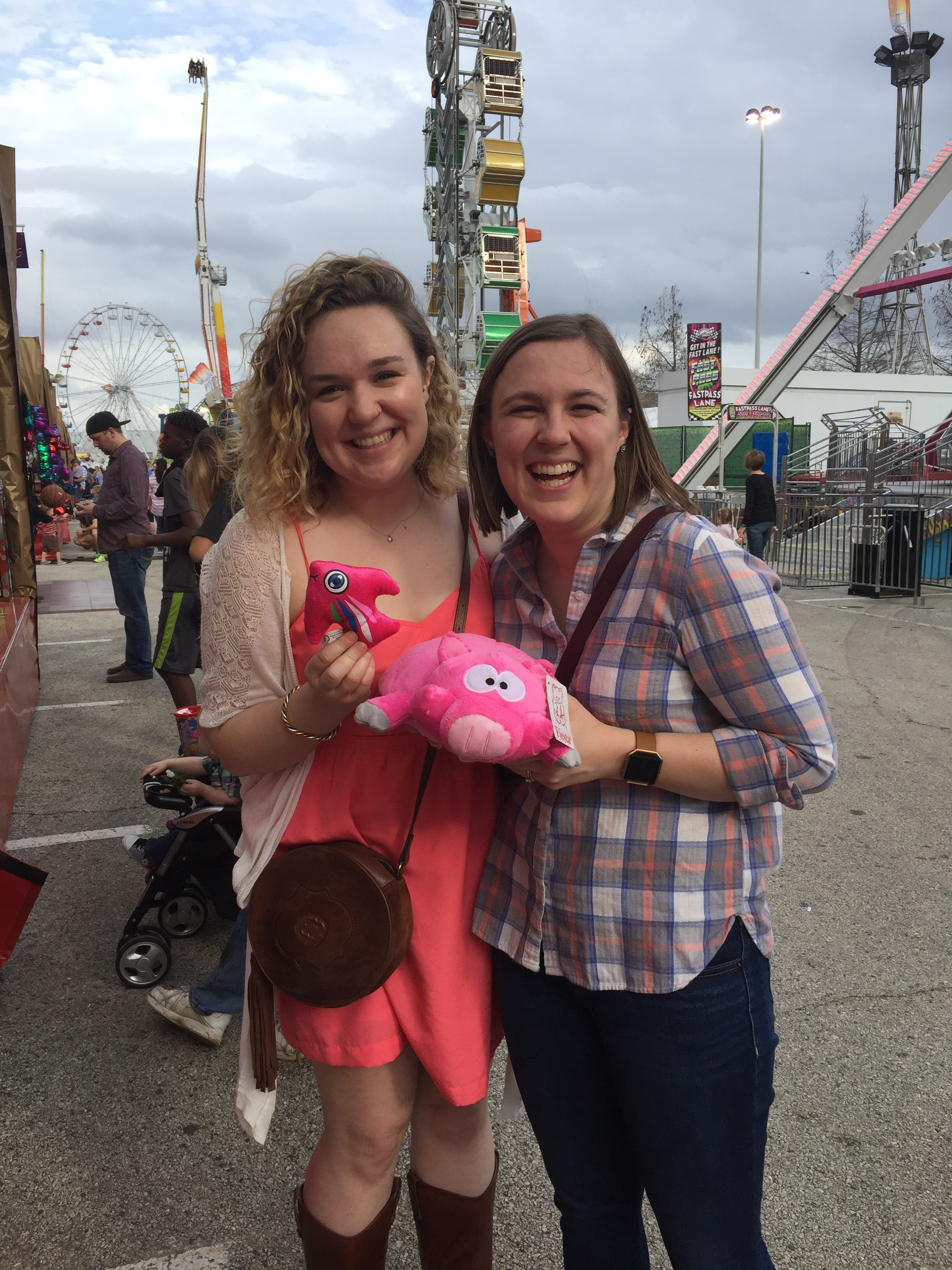 Elizabeth and Hadley showing off their prizes won at the 2018 Houston Rodeo Carnival.