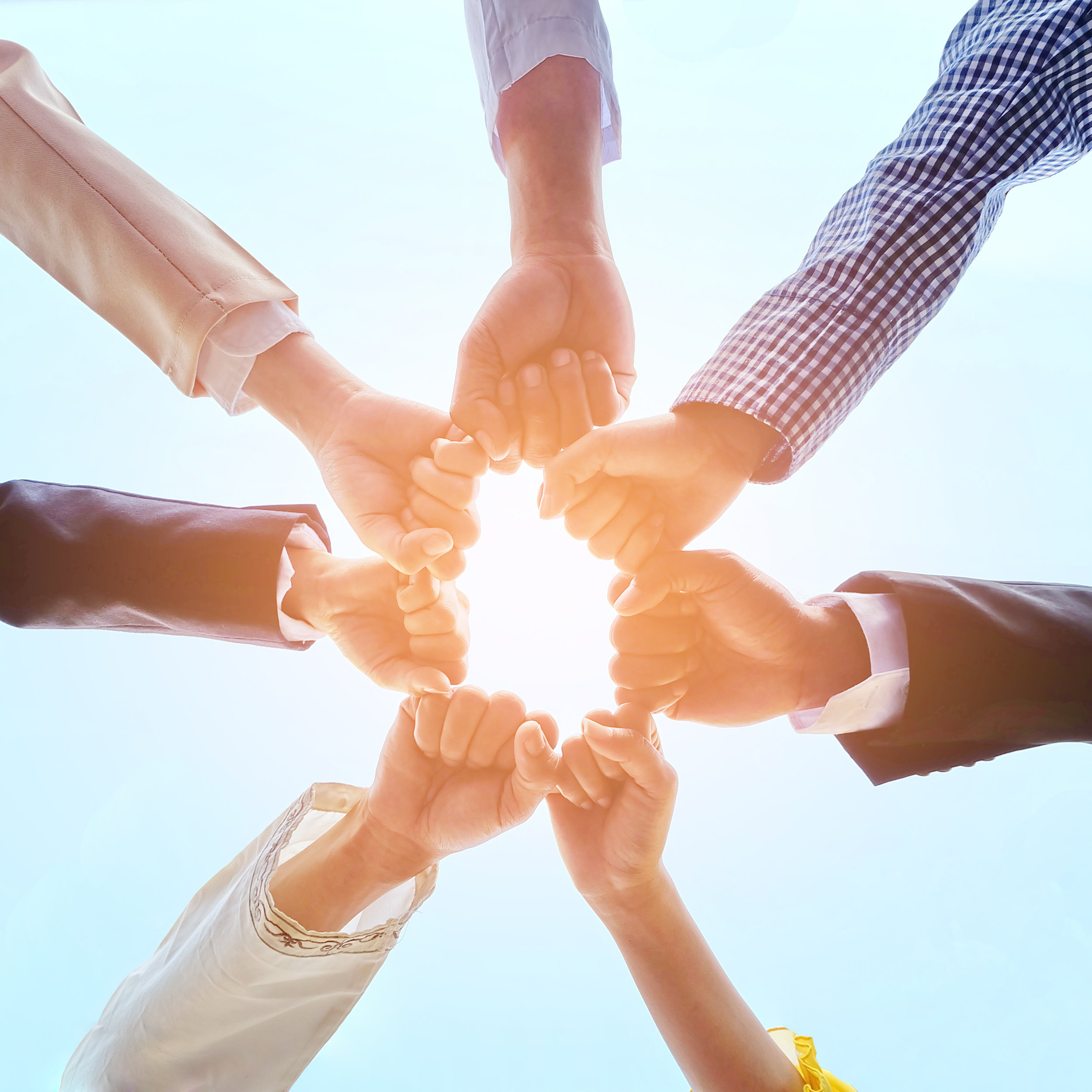 stock-photo-business-people-hands-as-symbol-of-their-partnership-and-strong-teamwork-540627958.jpg