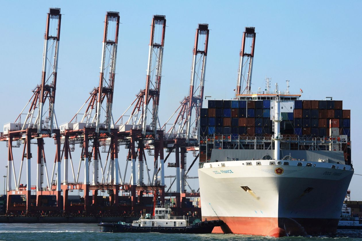 An Orient Overseas Container Line container ship is seen at a port in Qingdao, China.PHOTO:REUTERS