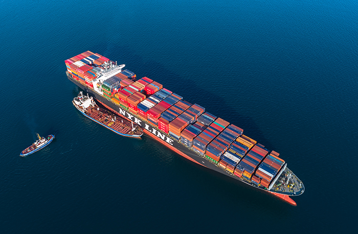 Container carriers will incur additional costs of as much as $265 per FEU from Asia to the US West Coast and $700 per FEU to the East Coast as a result of the low-sulfur fuel mandate, according to one study. Photo credit: Shutterstock.com.