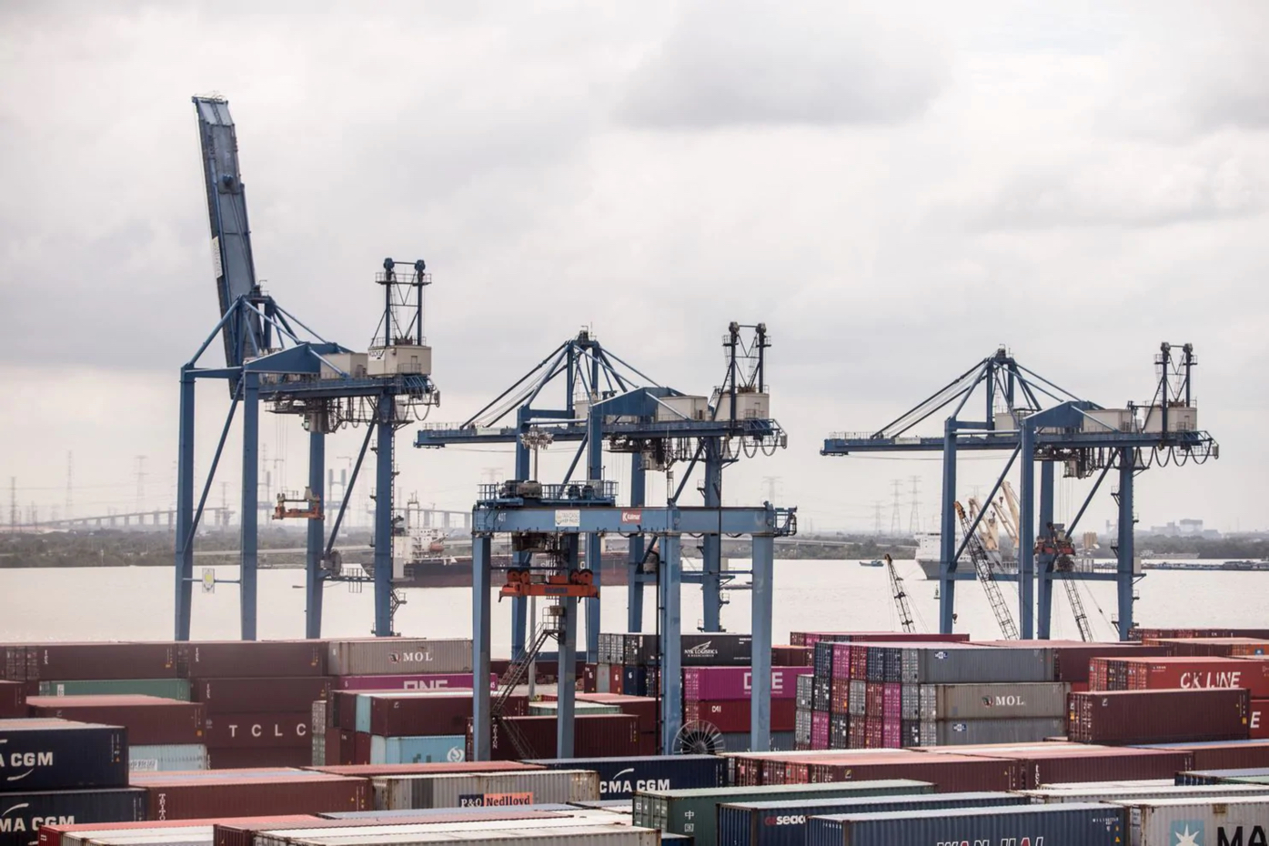 Gantry cranes stand next to containers at Tan Cang-Hiep Phuoc Port in Ho Chi Minh City, Vietnam, on June 27. Vietnam has benefited from a surge in exports and foreign investment as businesses look to scale back their China operations or relocate to avoid higher U.S. tariffs. (Yen Duong/Bloomberg News)
