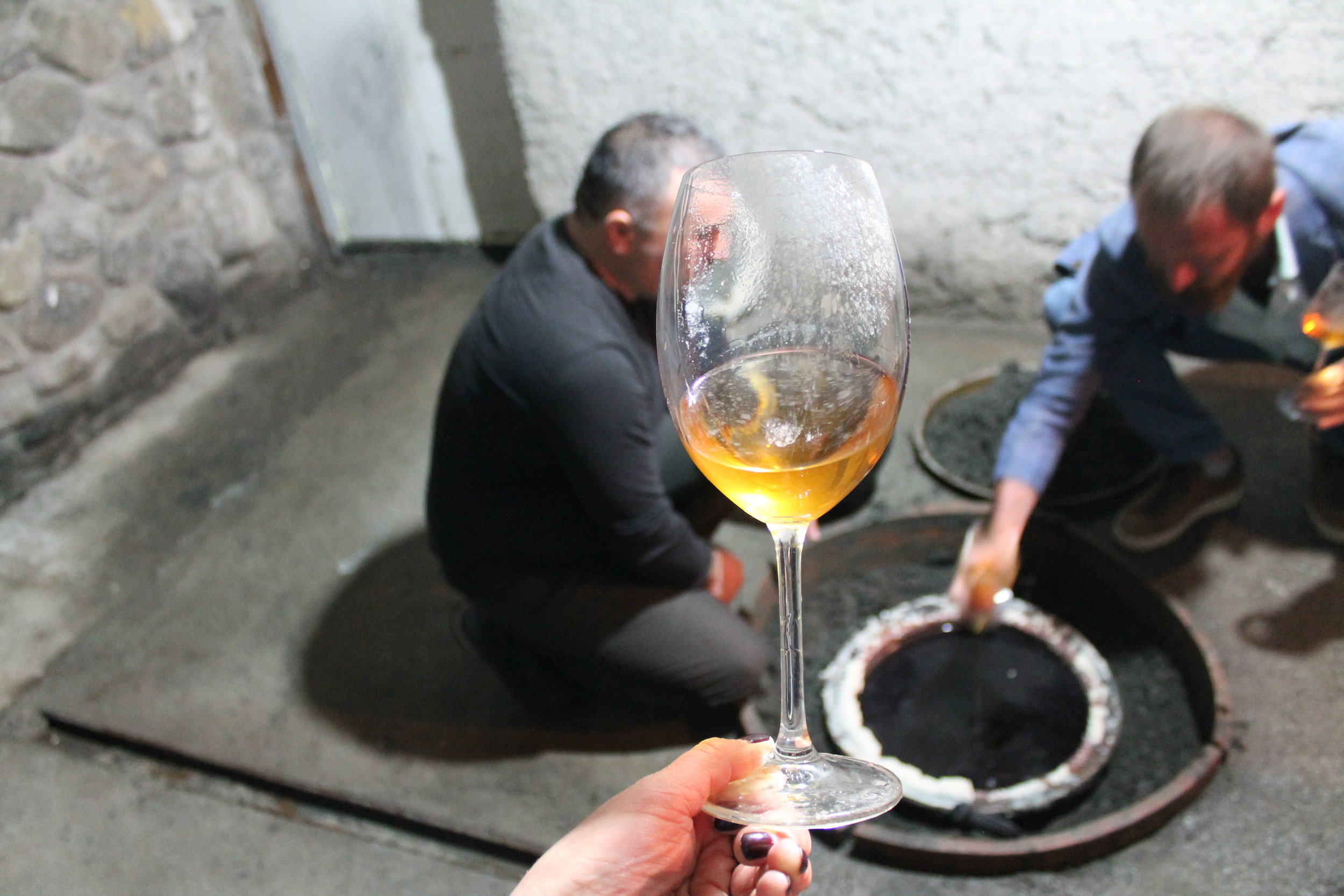Drinking amber wine from qvevri at Château Bruale.