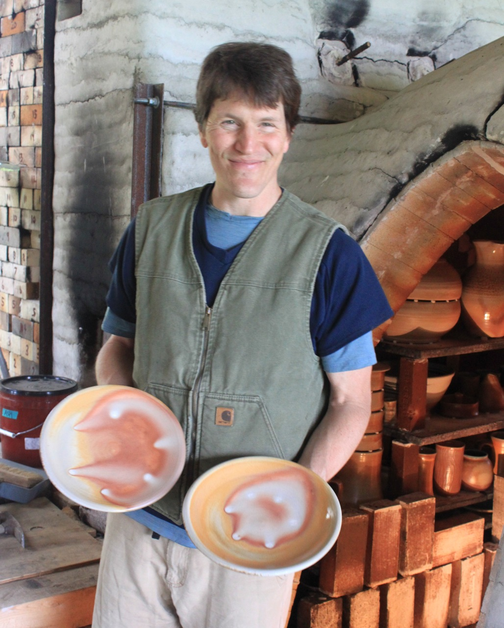 unloading the wood kiln at two potters