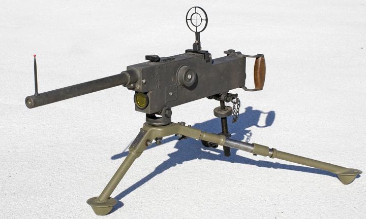 Fairchild Gun Camera H2   16mm movie camera simulating a Browning .30 caliber machine gun. Taking lens is beneath  lens barrel. Lens is unmarked.