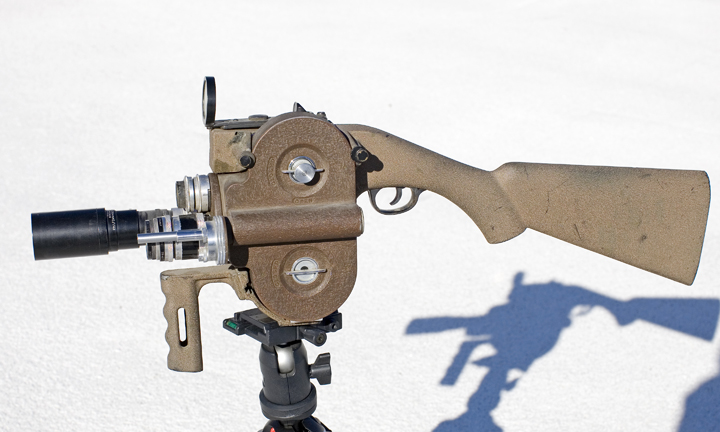 Filmo 16mm Movie Camera   Standard Filmo 3-lens turret camera, but mounted in a rifle stock with a dot reticle gunsight.