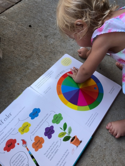 Evie playing with the Big Book of Colors