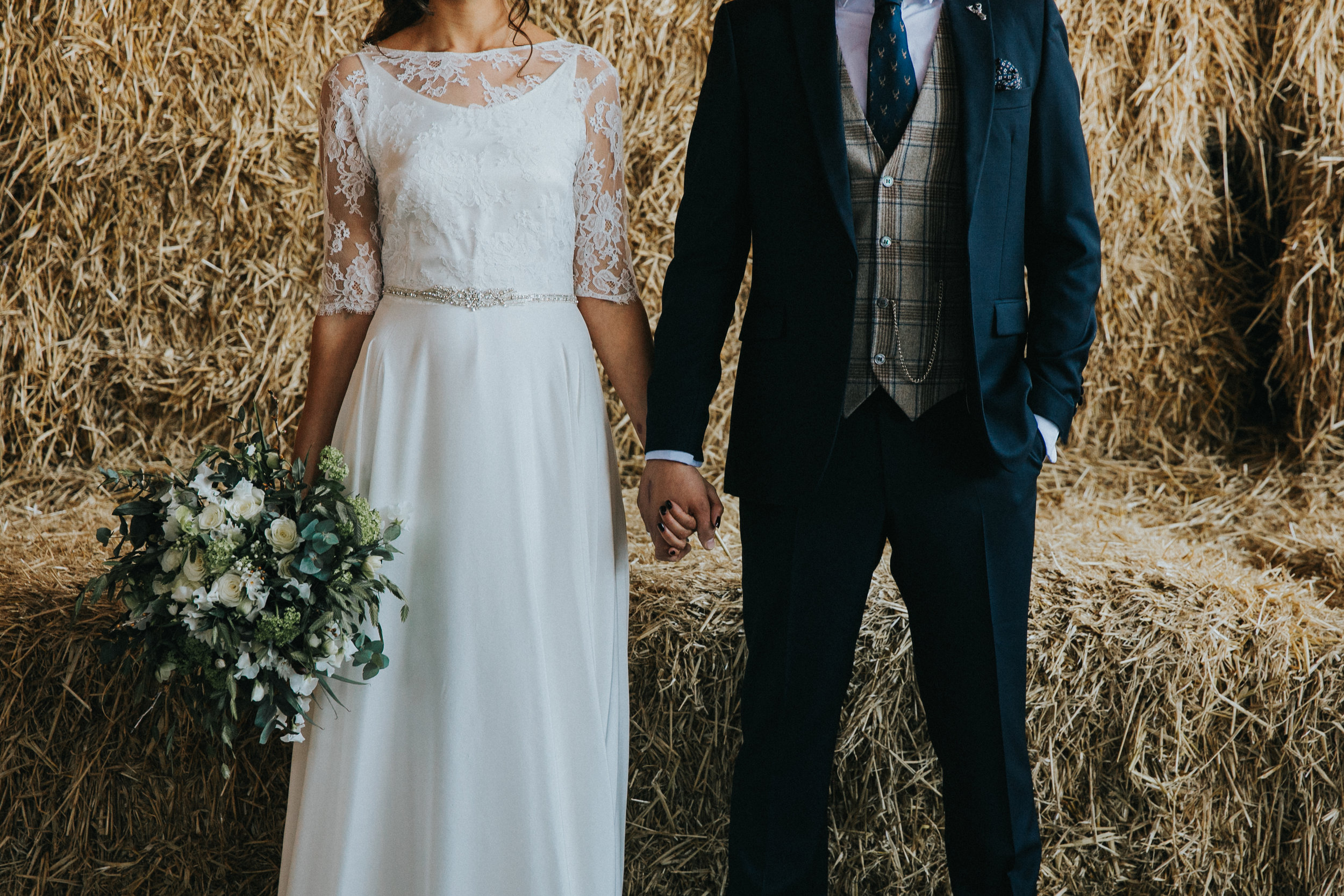 couple holding hands owen house wedding barn