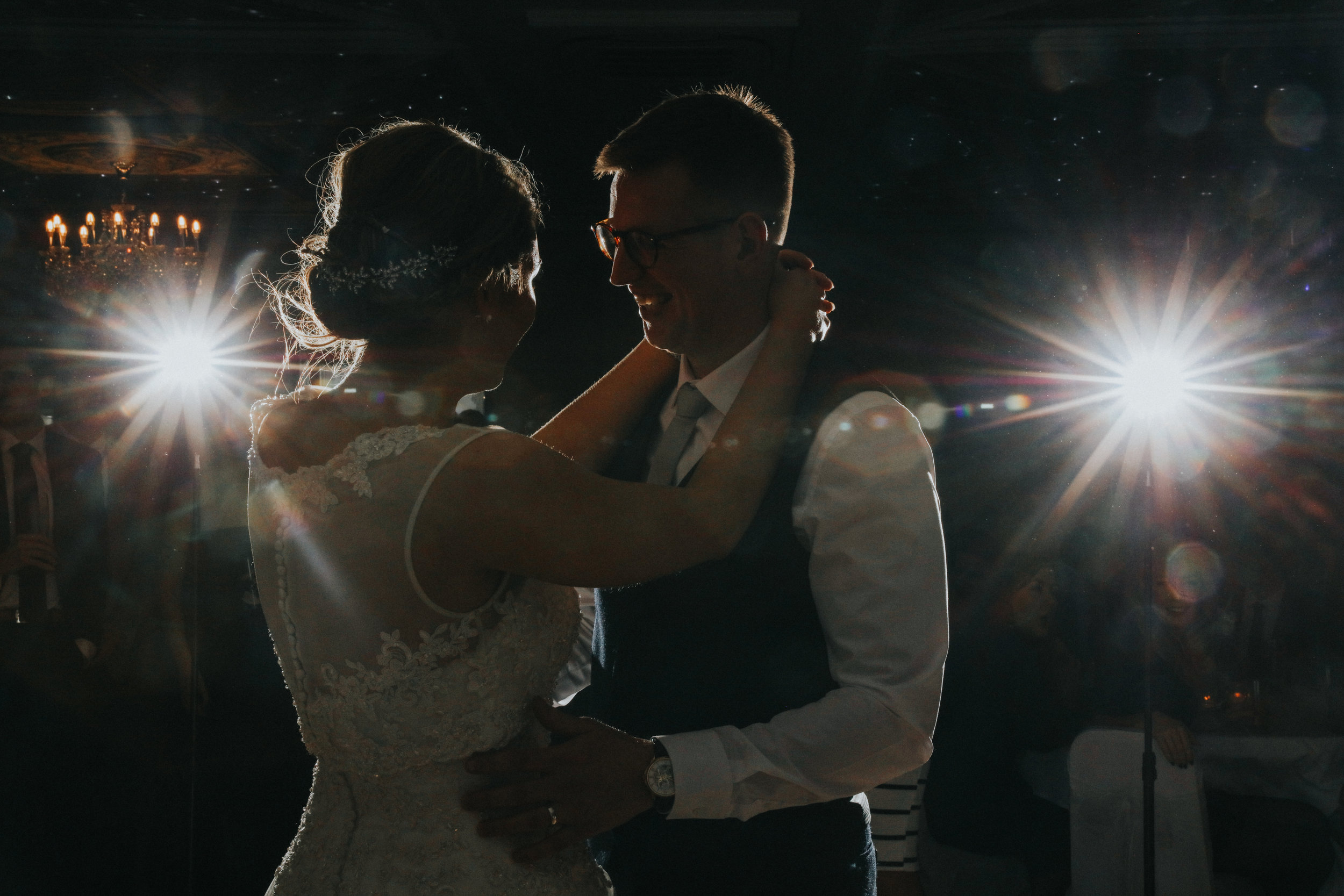 bride and groom cuddling while taking first dance