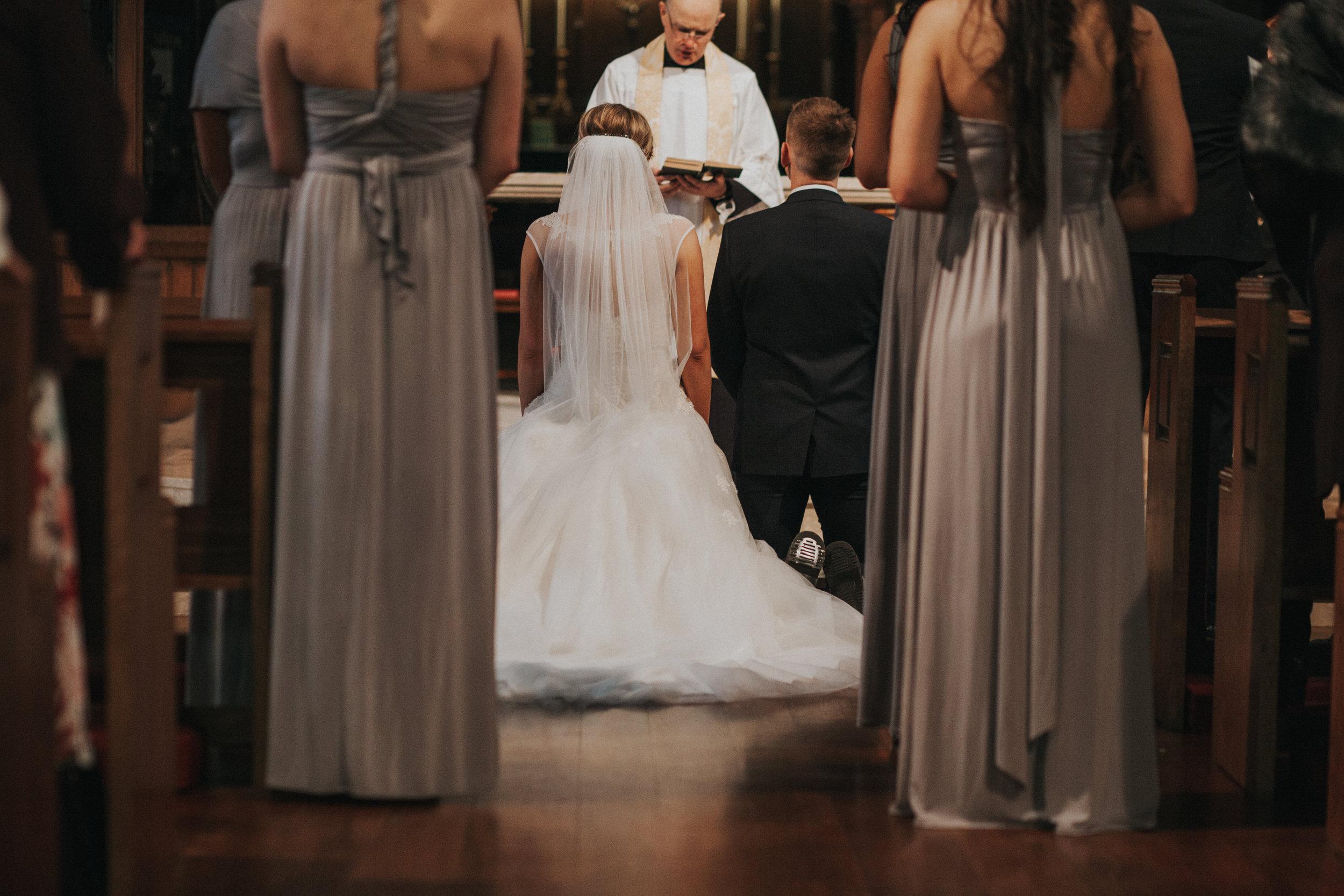 kneel at altar
