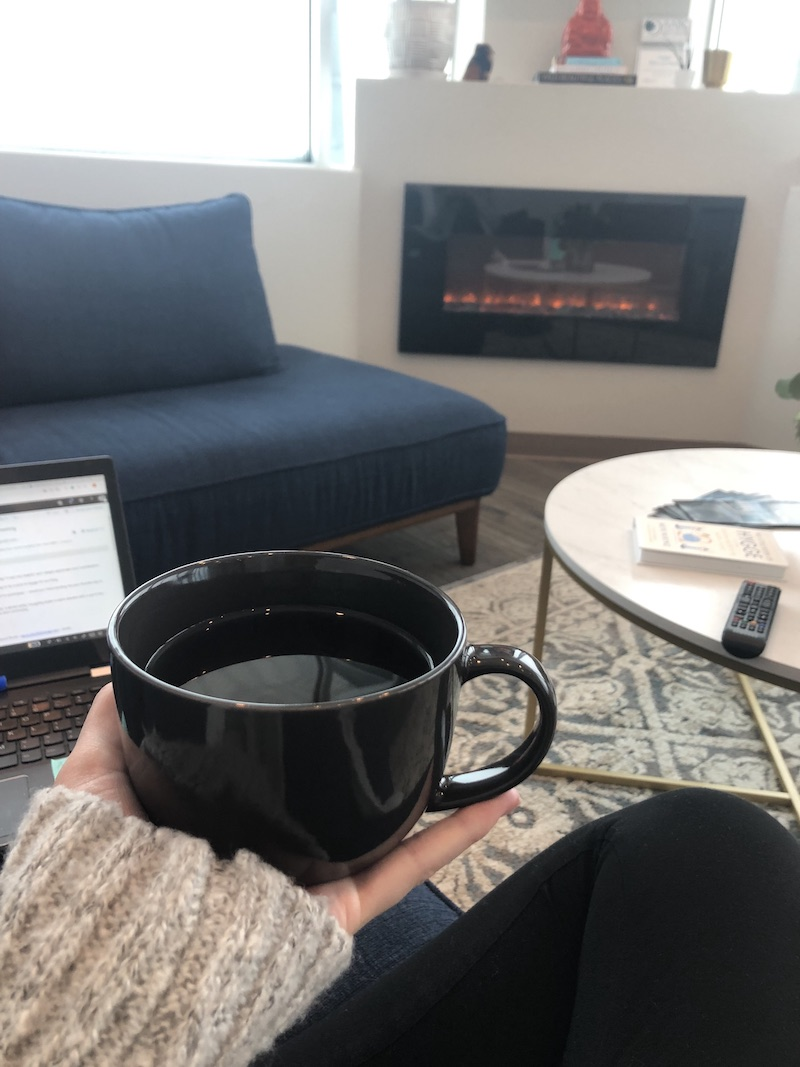 How we practice hygge in the Hygge Birth and Baby living room — with a fireplace and tea!