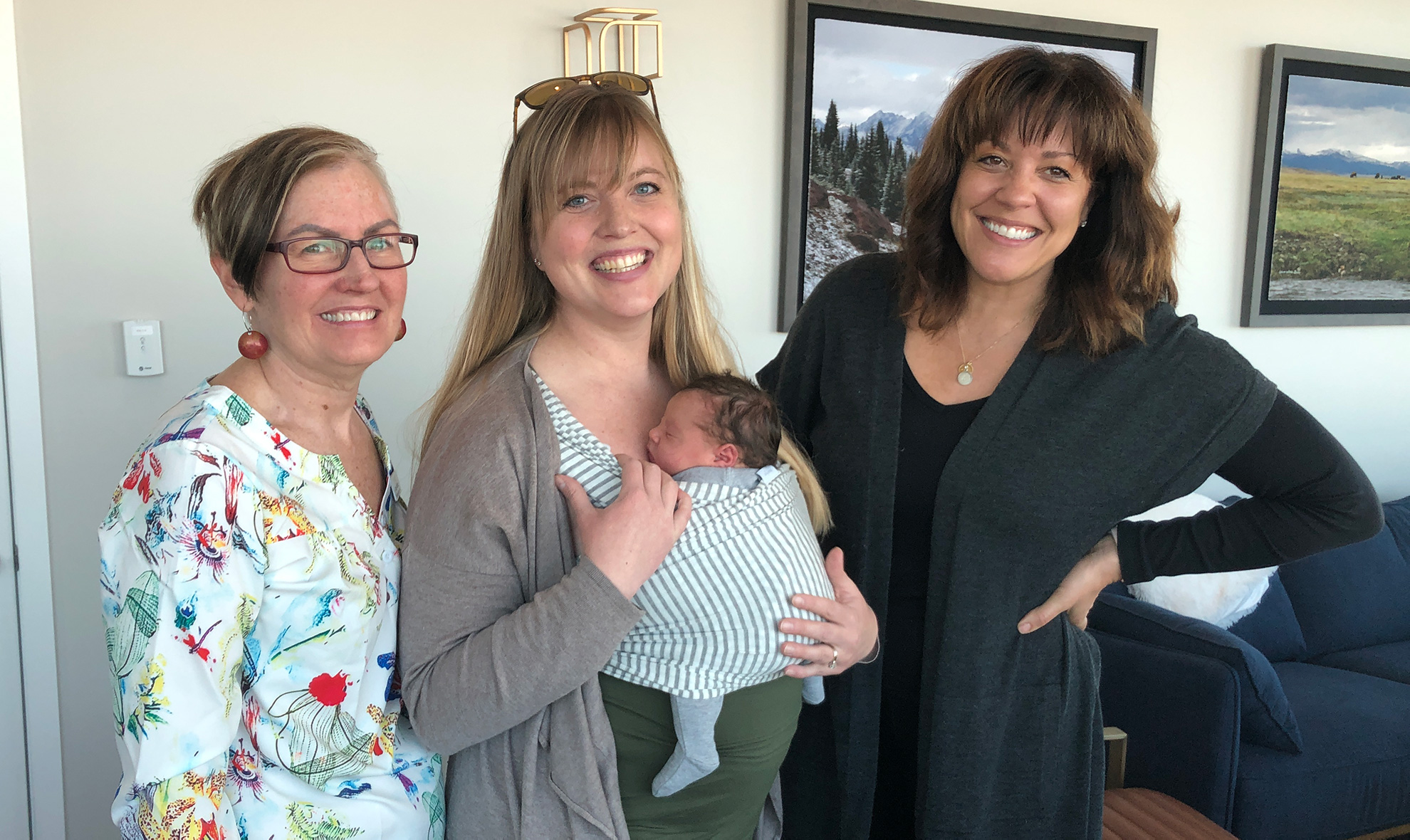 Midwife Anne and Doula Tara with a Hygge family