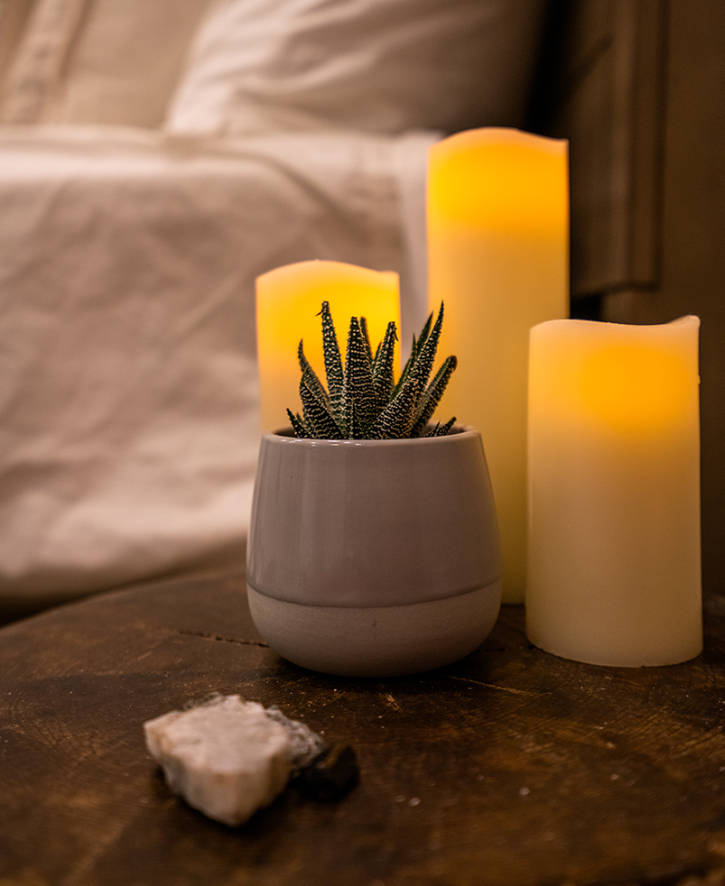 Candles and healing crystals create a sense of hygge in the fire suite.