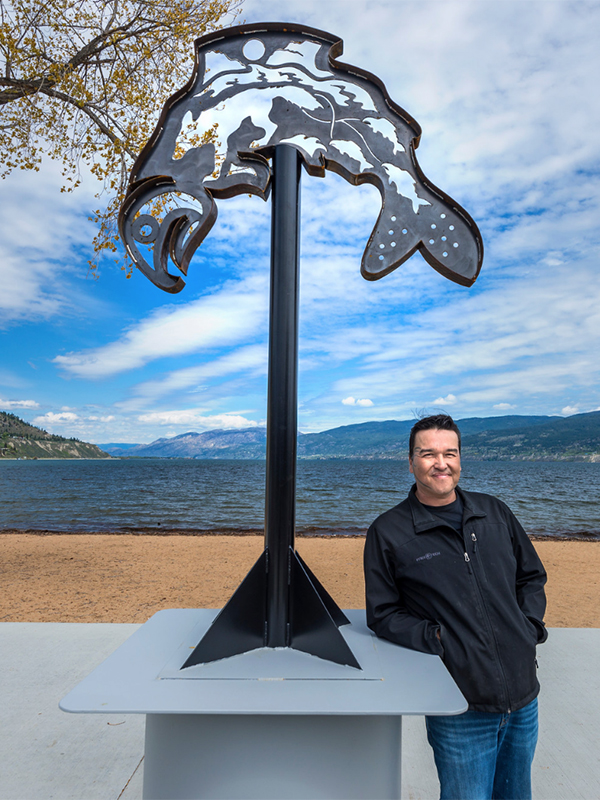 """Clint George with """"Bringing Back the Salmon Chief"""". Photo credit: John Poon"""