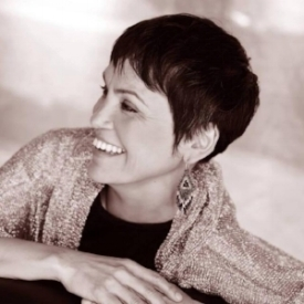 """SUSAN AGLUKARK     EXECUTIVE PRODUCER   SUSAN AGLUKARK is one of Canada's most unique and most honored artists. An Inuk from Arviat, Nunavut, Susan has been walking in a tension between two worlds, a defining note in her remarkable career. Aglukark's musical success is even more interesting when you realize she didn't start her career until she was 24, with no modern musical orthodoxy to draw on Aglukark was free to respond to the sounds and styles that touched or motivated or inspired her. The (real) appeal of her music is that in an era where the most popular music is often less relevant than style or mood, her lyrics are where she lives. """"The songs are driven by the stories. It's all about the stories.""""   Follow Susan on Twitter."""