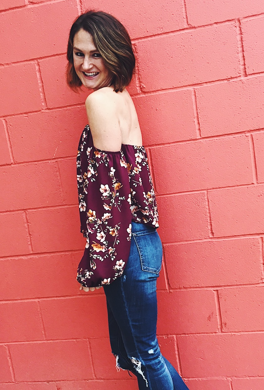 mixing feminine with edgy, floral shirt, distressed denim