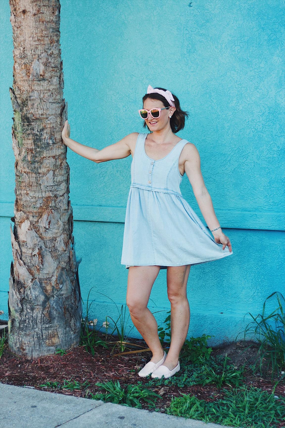 denim dress, pink sunglasses, pink hair wrap, pink moccasins
