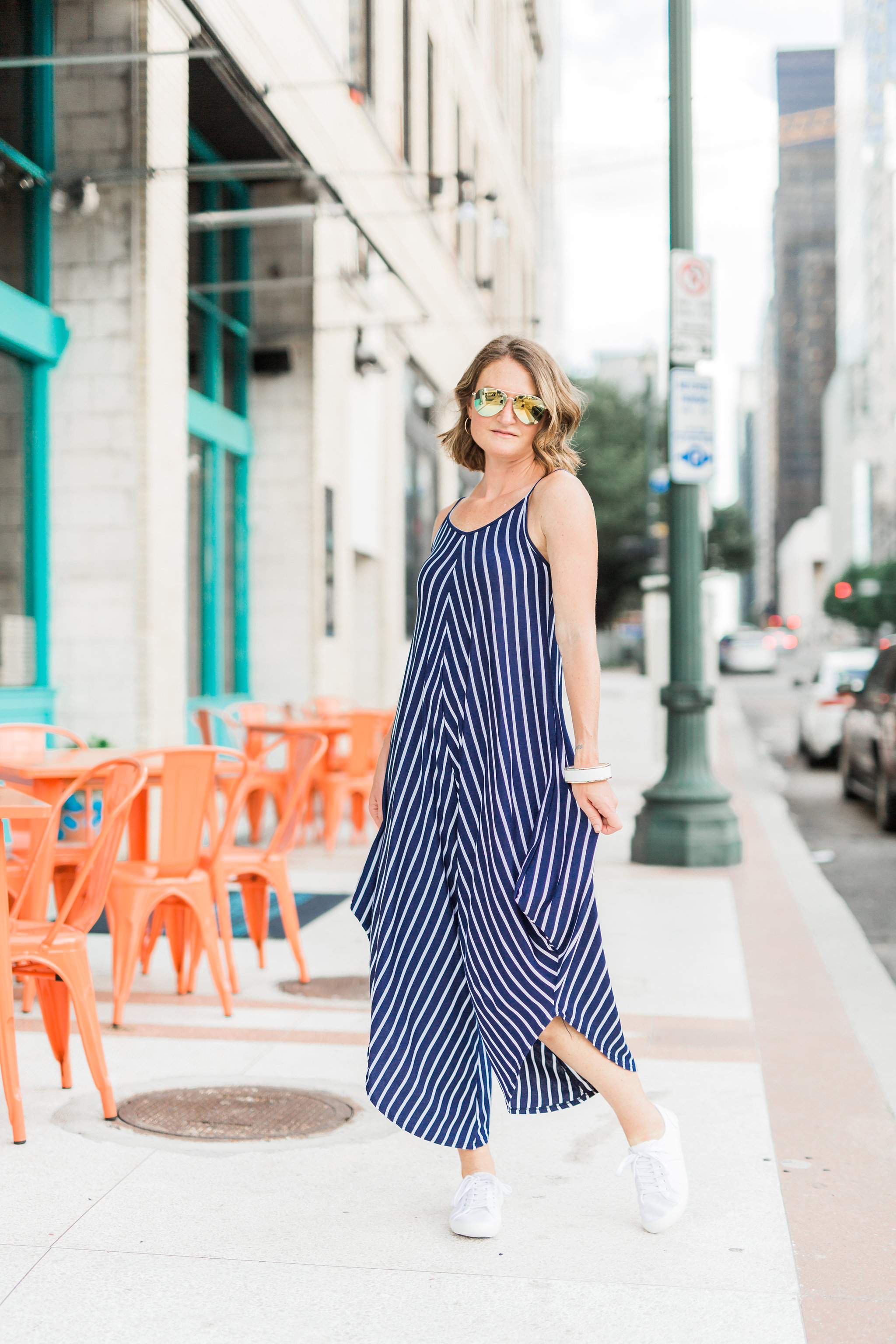 striped jumpsuit & mirrored sunglasses