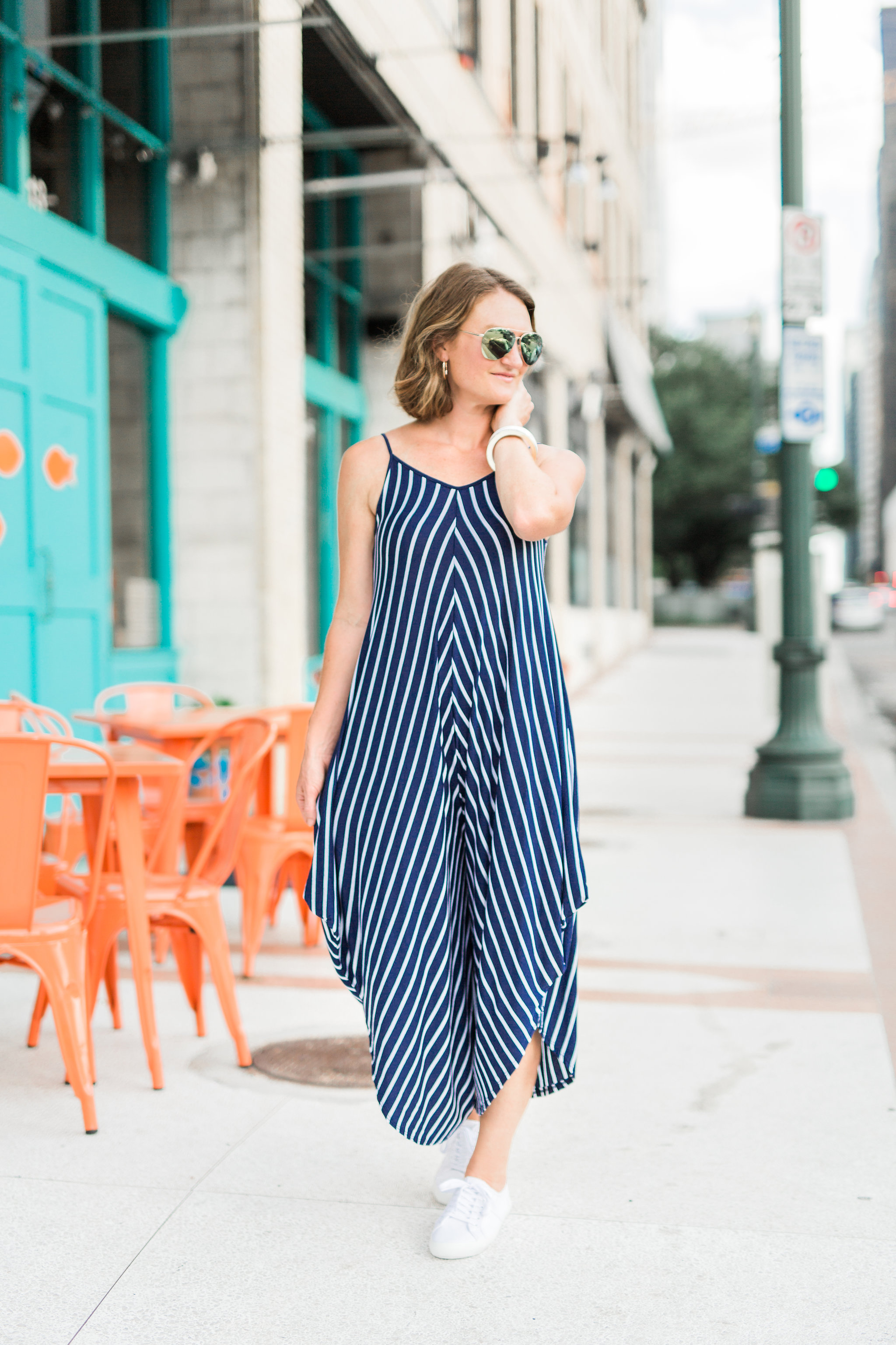 striped jumpsuit, mirrored aviators