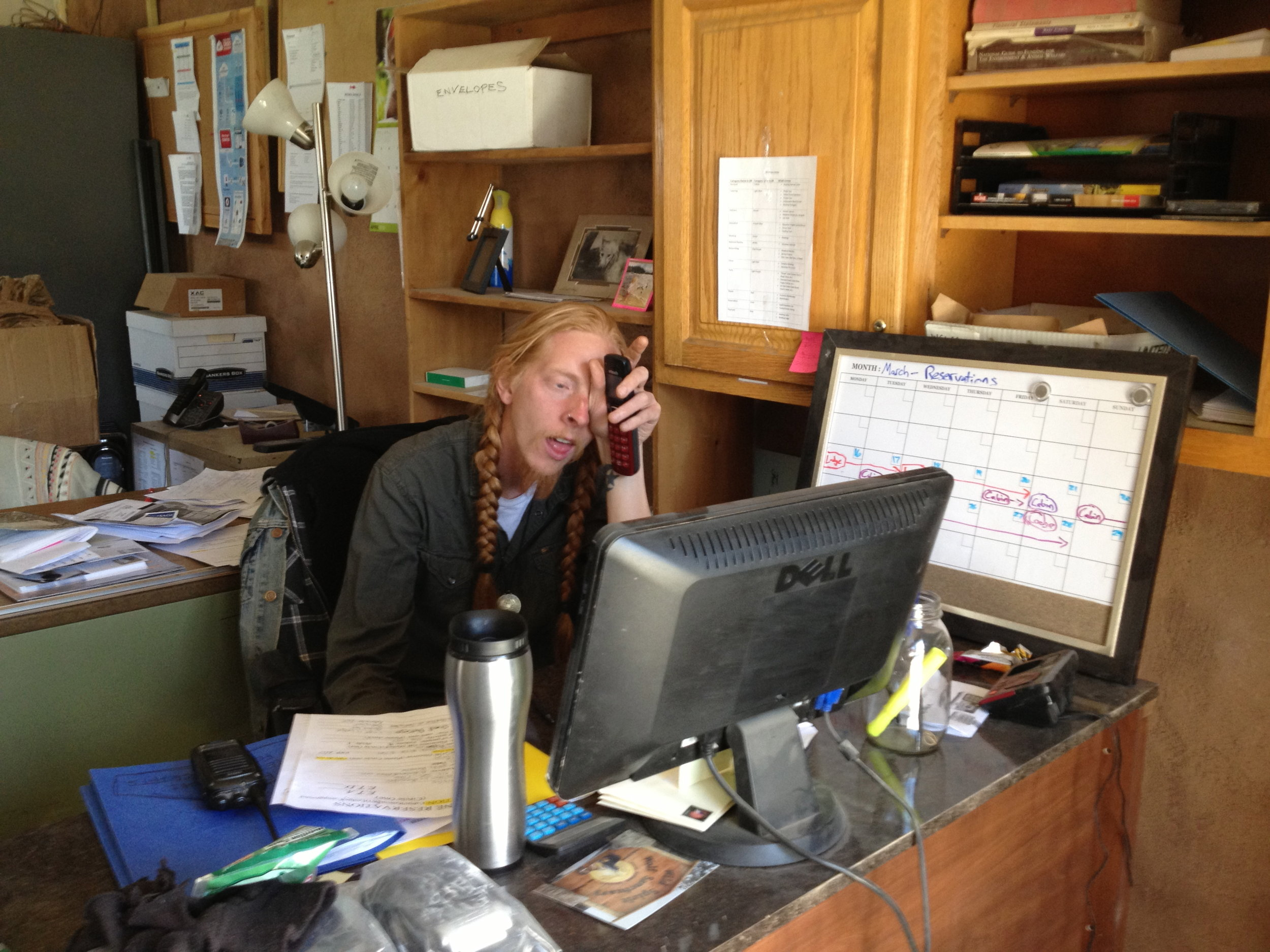 Event Coordinator Chadley swamped with phone calls in the office.