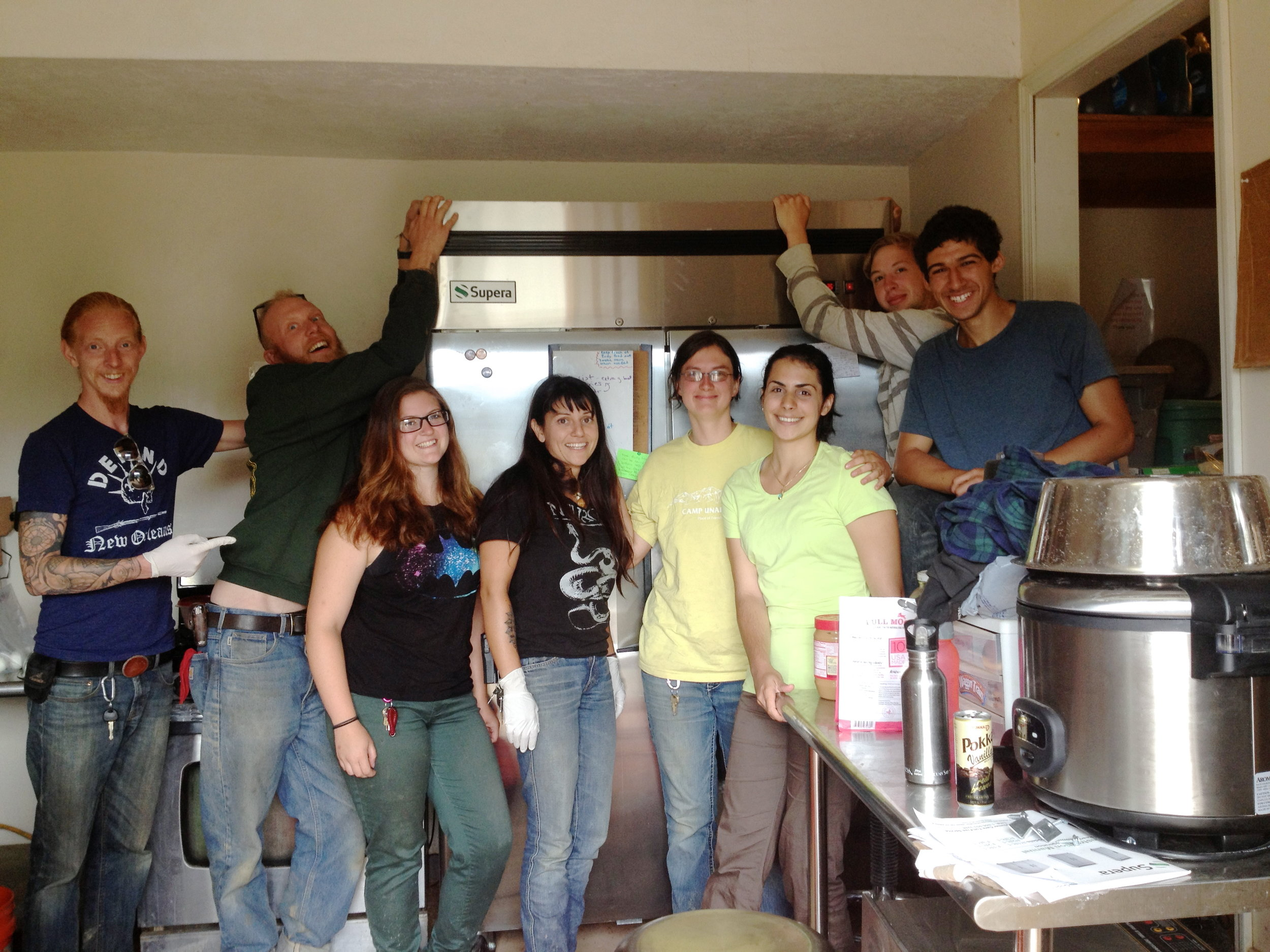 Above: Chadley, Eric, Sumitra, Amy, Eva, Paul and Mo happily pose to thank a donor for her generous gift of a shiny new Wolf Kitchen refrigerator. Below (L to R): Jaeger resting on Nikki's shoulder after scent-rolling on her head. Chadley and Contessa saying a happy hello.