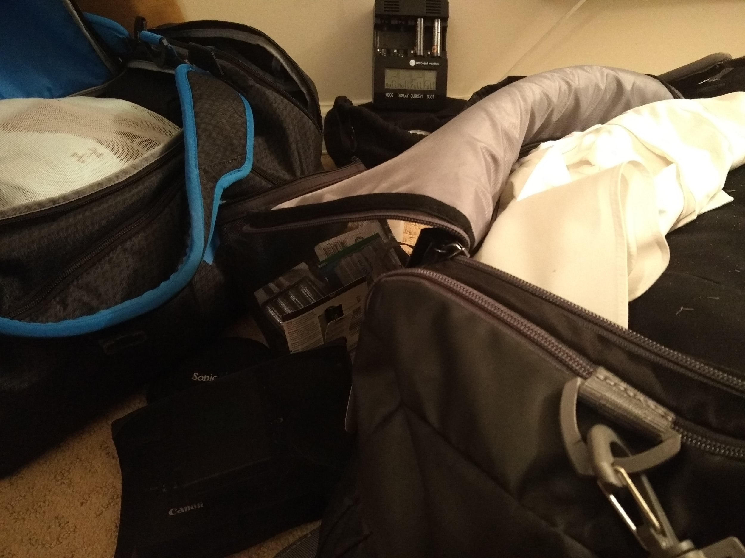 Camera gear and wedding clothes, all in our carry-on luggage!