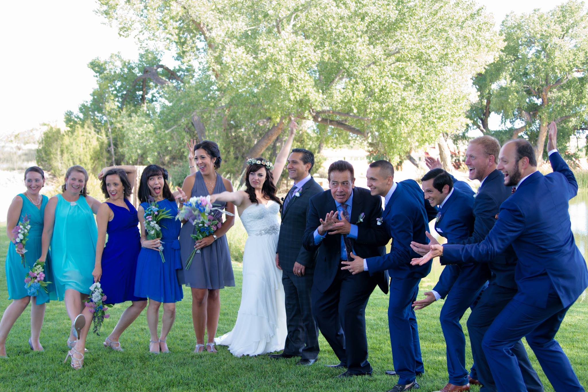 The bridal party celebrates a successful wedding!