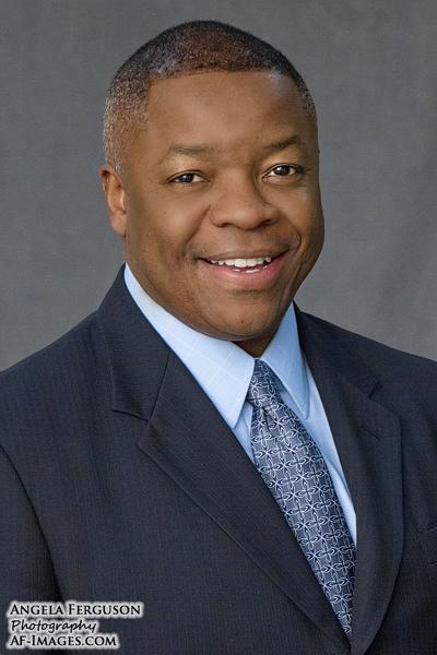 Male business headshot, gray backdrop. (Glen Burnie, MD)