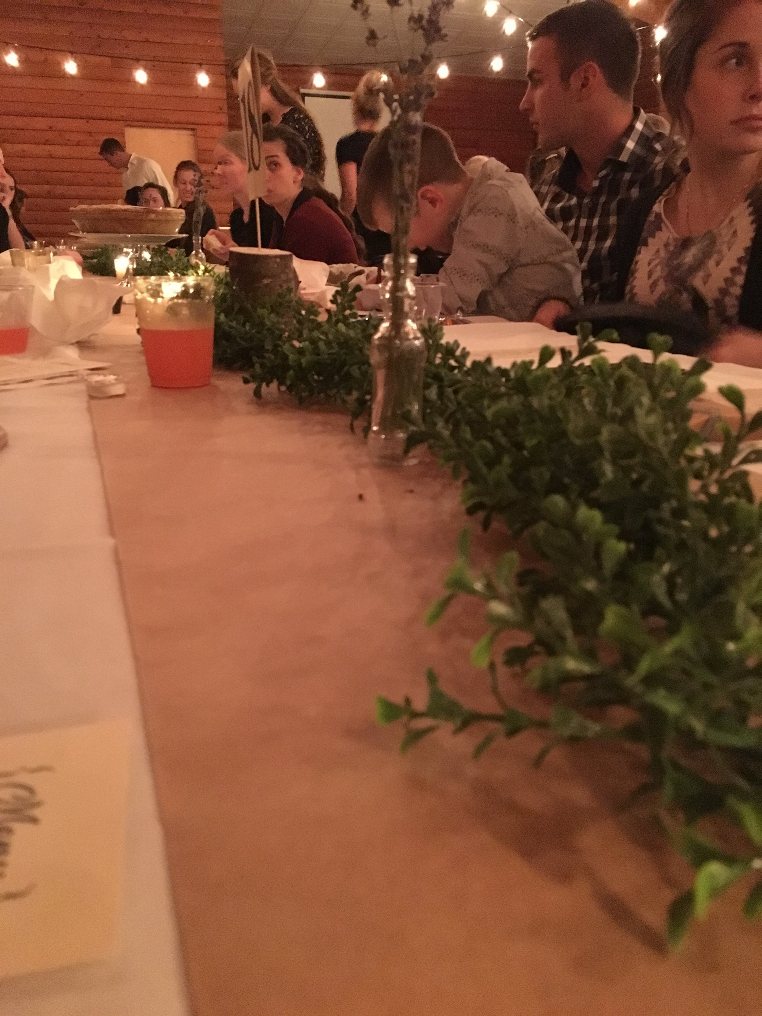 The table setting was little sprigs of lavender and greenery, with the table numbers poked into a small log