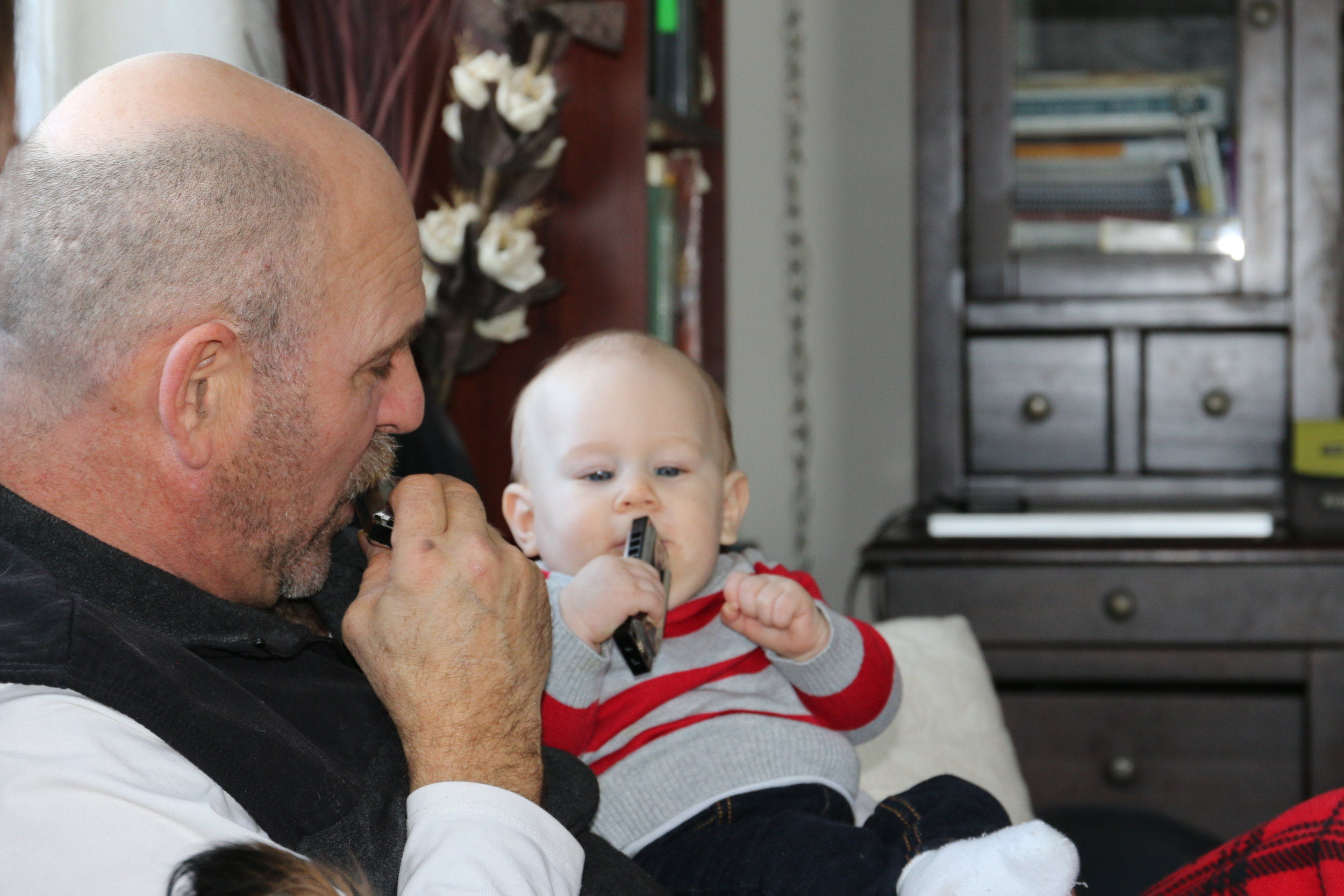 Playing the harmonica - Grandpa's little prodigy