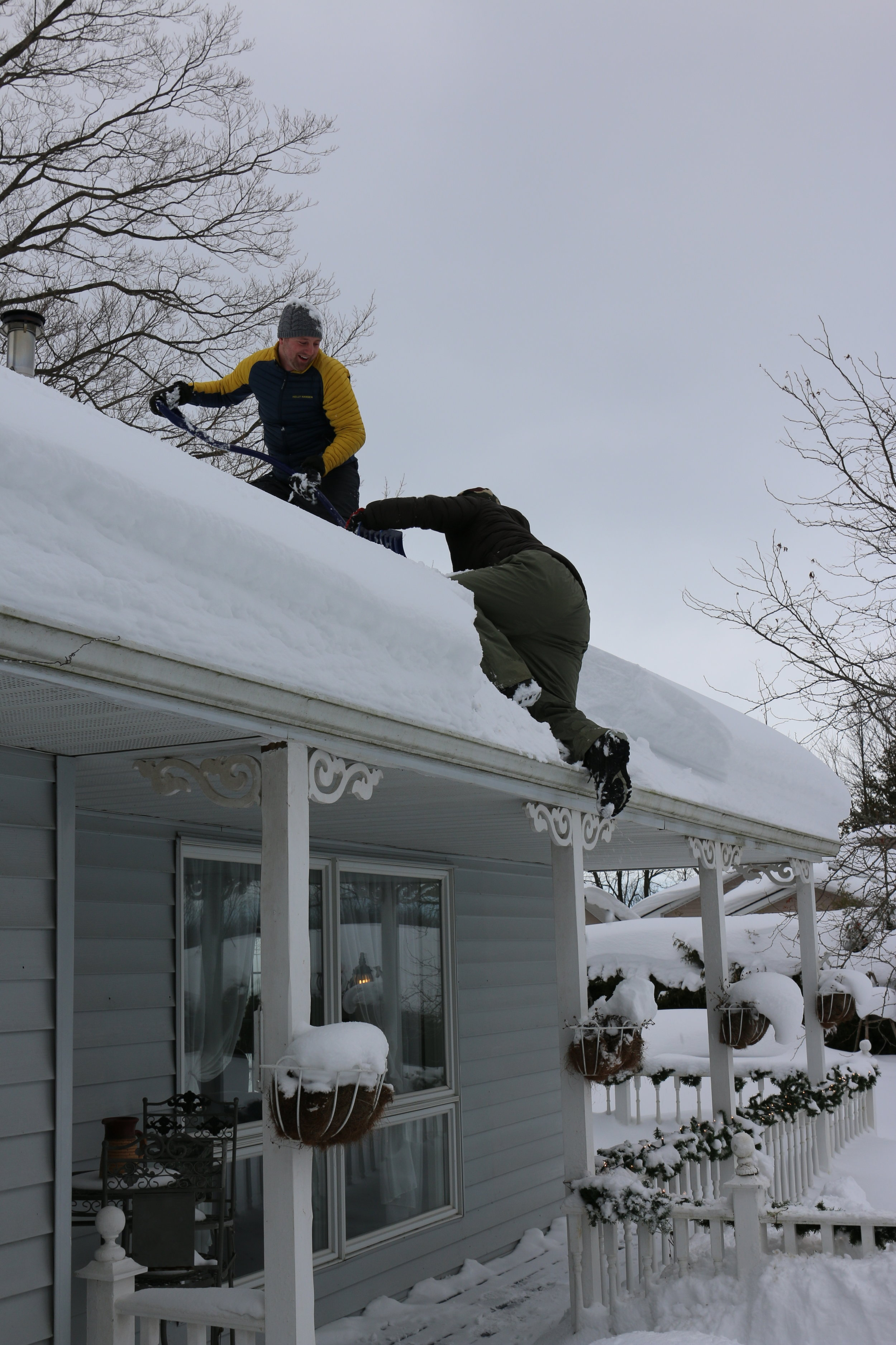 Getting up on the roof to shovel the snowfall