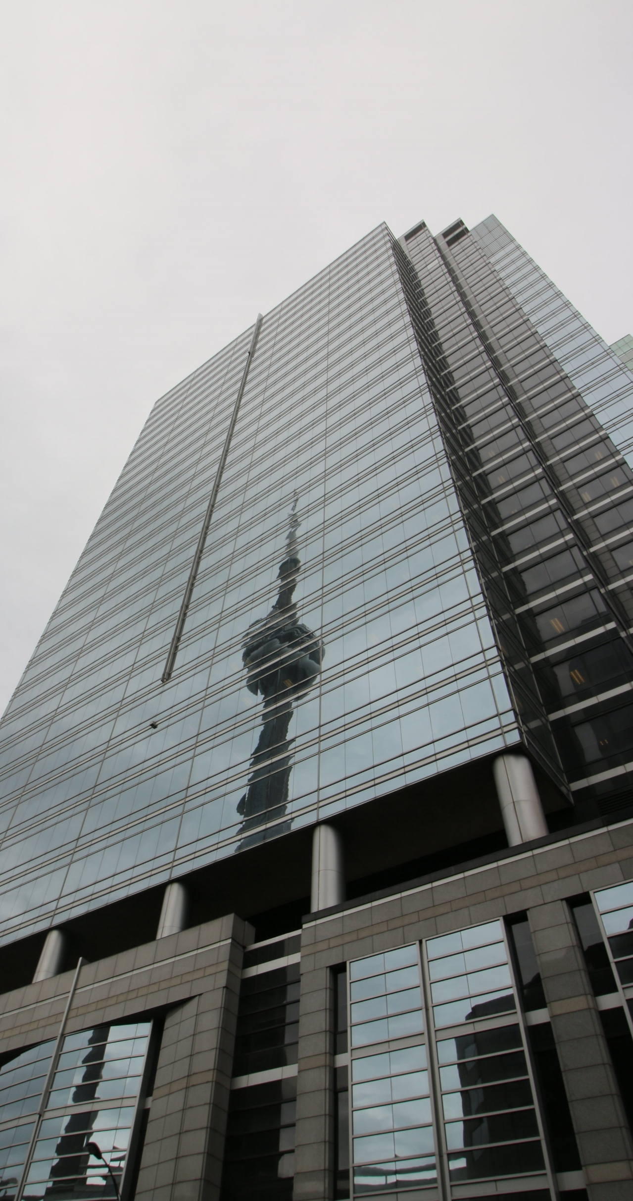 Skyscraper reflecting the CN Tower