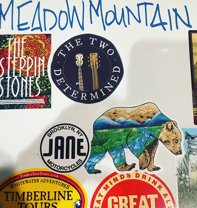 It's always a good day when your merch makes the cut for @haileyvest's famous mini fridge sticker collection. We're proud to share limited space with such fun, talented folks! @meadowmountain @greatdividebrew @planet.bluegrass