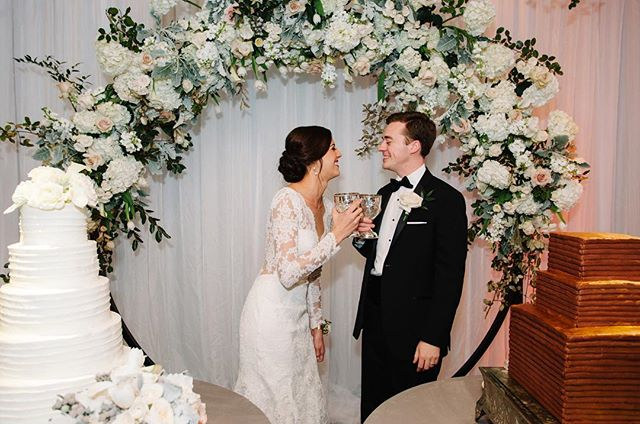 From our very first meeting, Lundy had the beautiful idea to create a floral arch that would serve as the backdrop for the bride and grooms cake. With the help of @chelseaantiques1, we designed this massive 12 feet tall floral ring that greeted guests as they made their way up to the ball room for the fun reception! 🌸✨#afewofourfavoritethings #edelweissdesignhouse . . . . . #EDHfloral #EDHweddings #florist #weddingphotography #weddings #vsco #thatsdarling #engaged #bride #marthastewartweddings #southernbride #southernweddings #alabamaweddings #destinationwedding #theknot #thehappynow #pursuepretty #travel #oncewed #flashesofdelight #beautifulmatters #liveunscripted