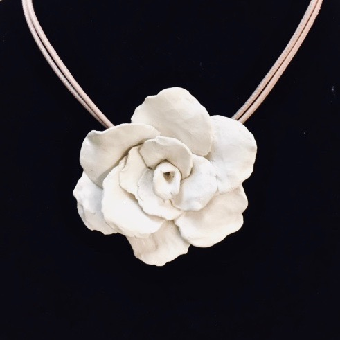 single flower on sueded blush pink double cord / lg. sterling lobster claw clasp