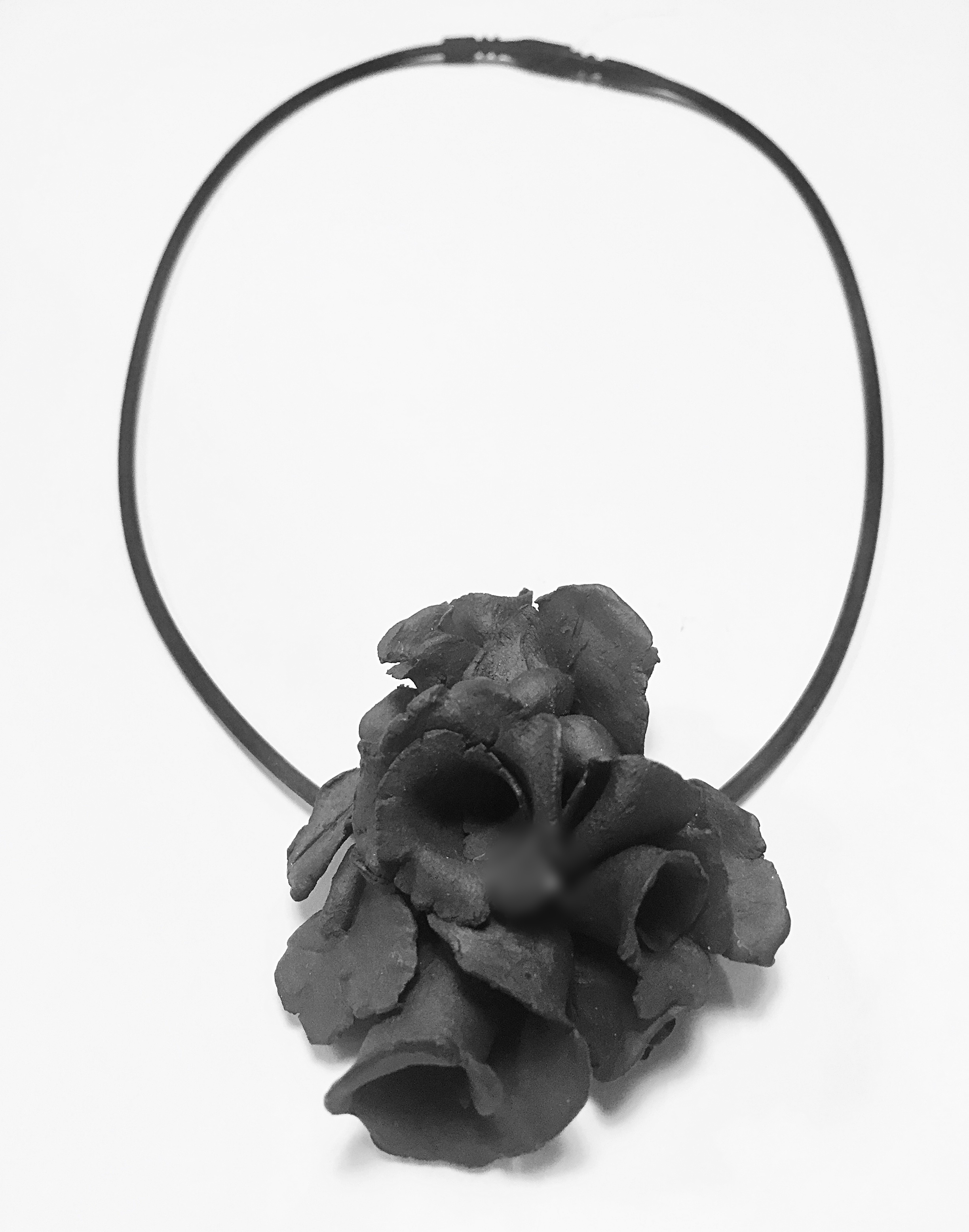 small black clay bouquet with black rubber cord