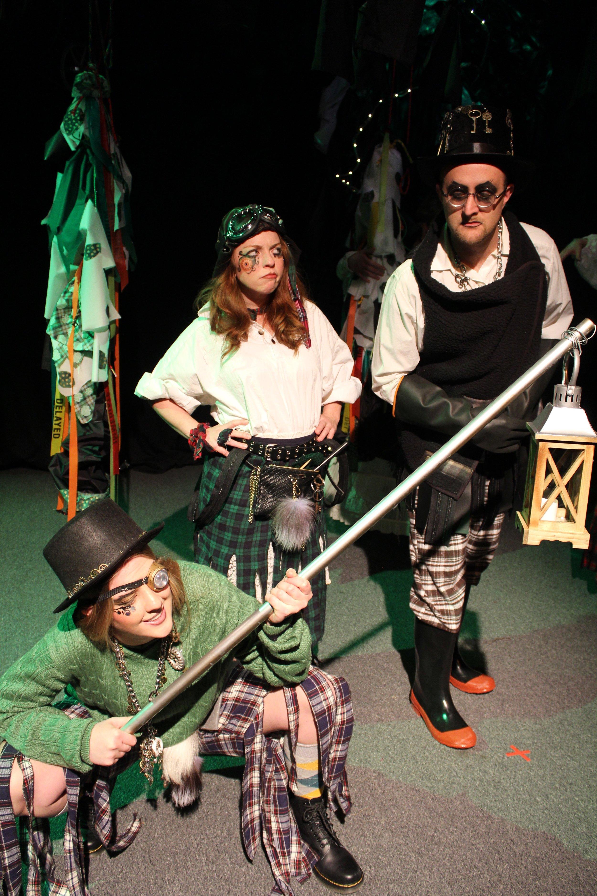 Hannah Carmichael as The Minion, Karin Carr as The Lass, and  Ryan Barnett as The Mischanter