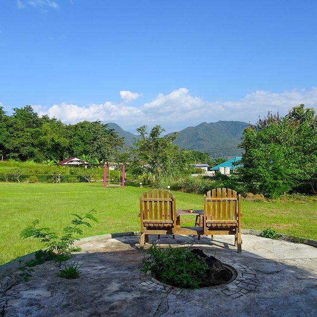 Missing this view a little extra today! Derrick and I spent many afternoons in these Adirondack chairs (Changs in hand 🍺 😉) enjoying the slow-paced lifestyle of Pai, Thailand during our stay at @tribalpaibackpackers. We rented a little bungalow to ourselves so we could get some work done in the mornings before riding the motorbike into town or around the countryside for the day. To us, it was a true slice of paradise! • Pai has, unfortunately, received a reputation as a hippie/touristy backpackers-haven but (if you couldn't tell) Derrick and I found a lot more to love than to hate. We wrote about the five reasons we fell in love with this northern Thailand gem on our blog (#linkinbio) and we're hoping it helps fellow travelers find the same beauty we did ❤️ . . . . #paithailand #pailand #tribalpai #hostel #travel #traveltips #travelblogger #travelgram #travelviews #travelmore #travelplanning #travelinspiration #thailand #thailandtravel #thailandinstagram #thaigram #travelcouple #travelwriters #thailandtips