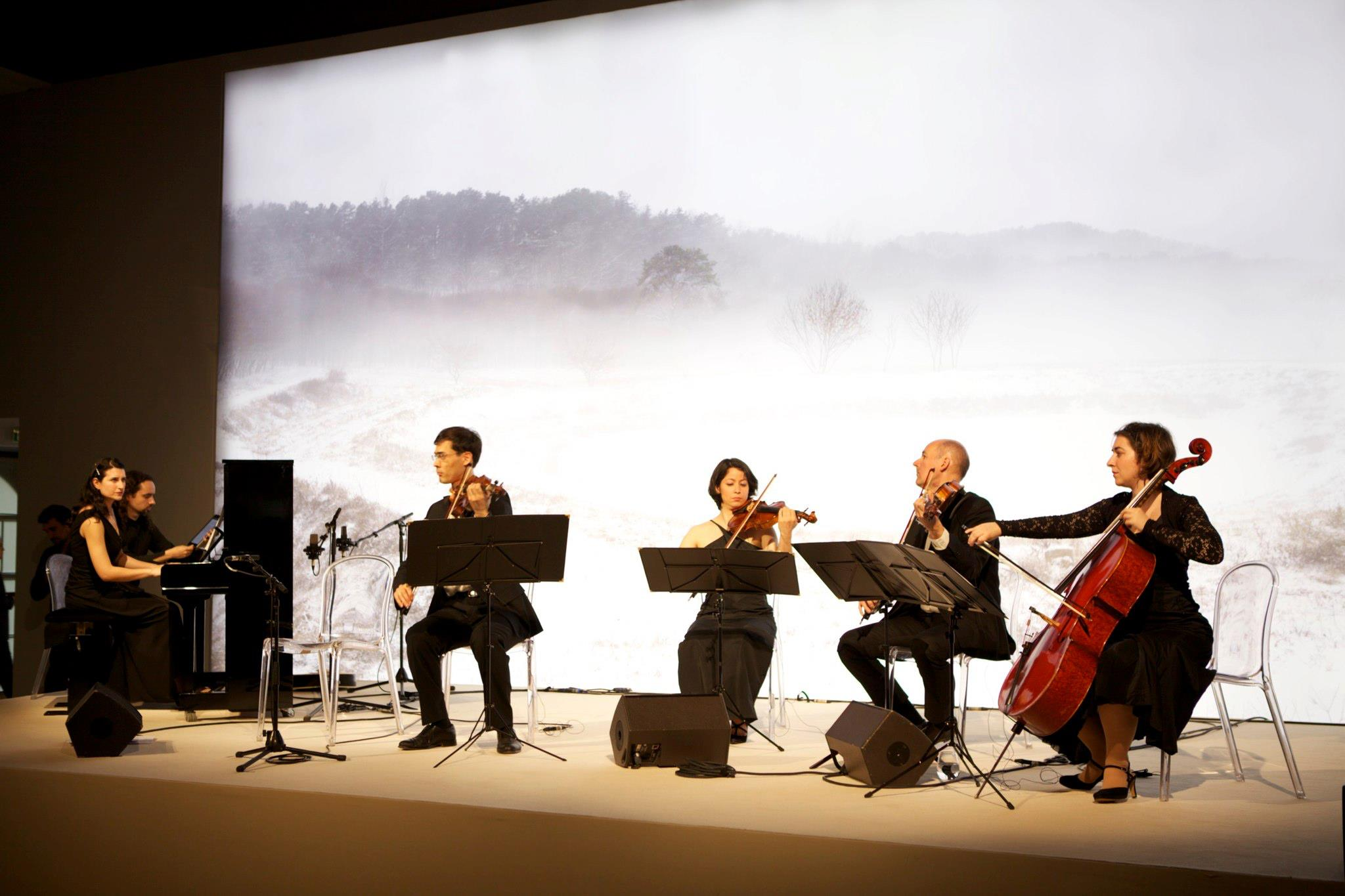 "Performing at the Louvre Museum for the photo scoring project ""Through My Window"" with a string quartet comprised of members of the Orchestre de Paris and the concert master of the London Symphony Orchestra."