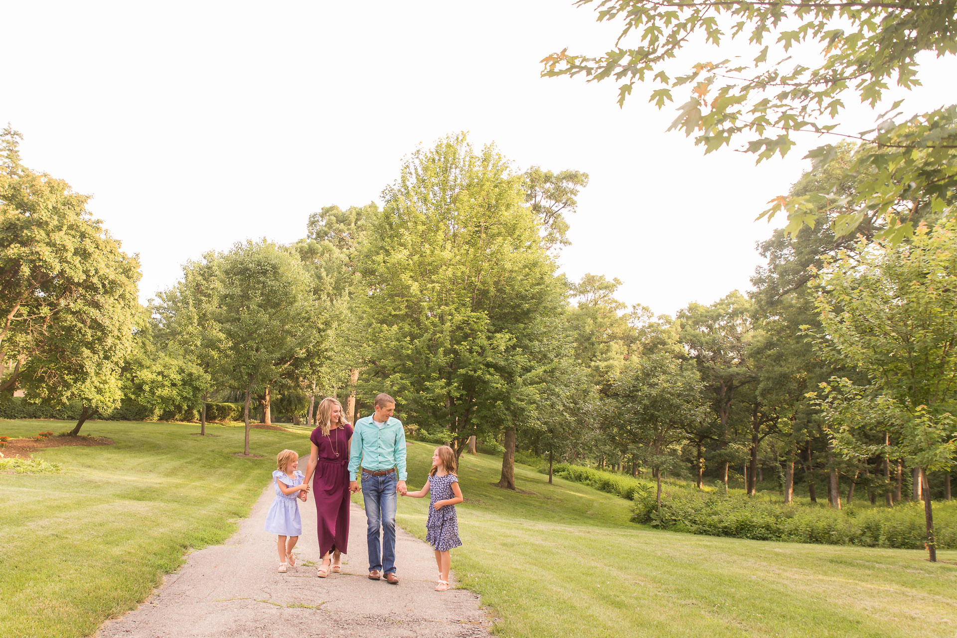 Family-Photography-Des-Moines-Family-Walking-On-Path