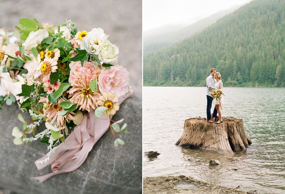 white pink yellow and green bouquet and couple standing on tree stump in water at rattlesnake lake