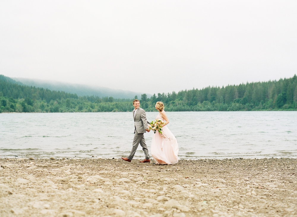 couple strolling alongside rattlesnake lake