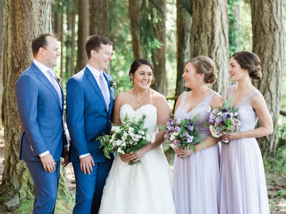 bridal party holding white and lavender spring bouquets