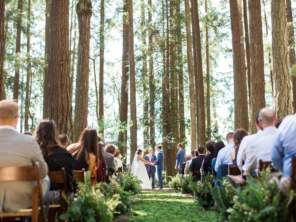 wedding ceremony in pnw wooded site