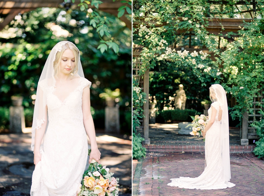 bride holding a yellow bouquet under a yellow rose covered arbor
