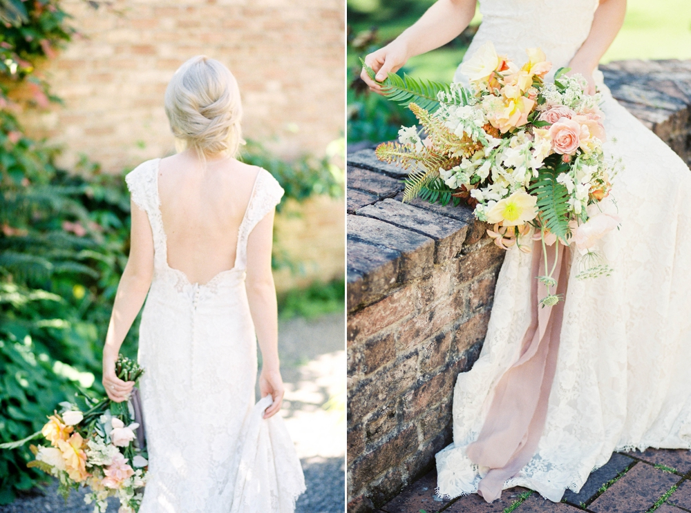 bride wearing a plunging back lace gown holding a pink and yellow rose bouquet